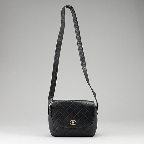 Chanel, a quilted, black caviar leather handbag.