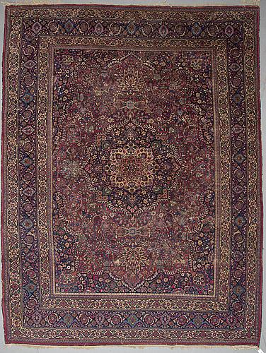 A carpet, semi-antique mashad, ca 433 x 239 cm.