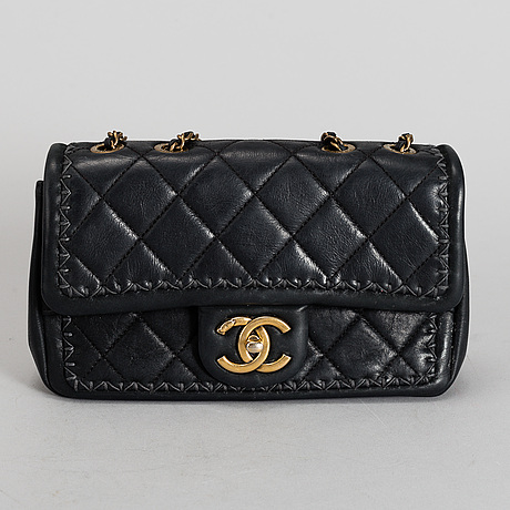 Chanel, a black quilted fabric 'flap bag', 2015-2016.