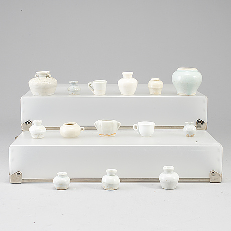 Fourteen miniature ceramic vases, south east asia, presumably 17th century.