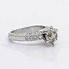 Ring 14k vitguld m 1 briljant ca 1,8 ct, ca l-m vs, sidostenar ca 0,25 ct totalt.