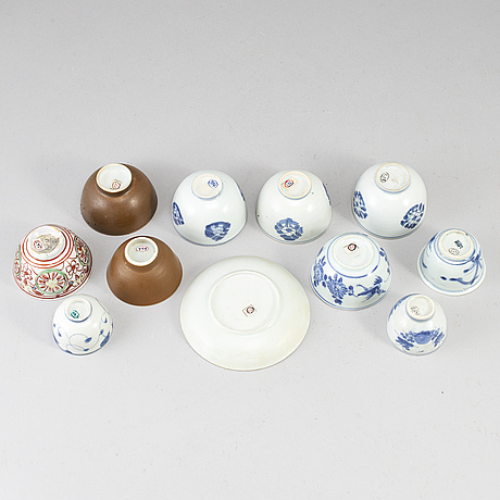 Eleven porcelain cups with one dish, mostly qing dynasty, 18th century.