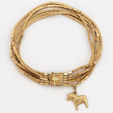18k gold bracelet, with charm.
