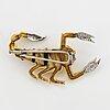 Brilliant-cut diamond scorpion brooch.
