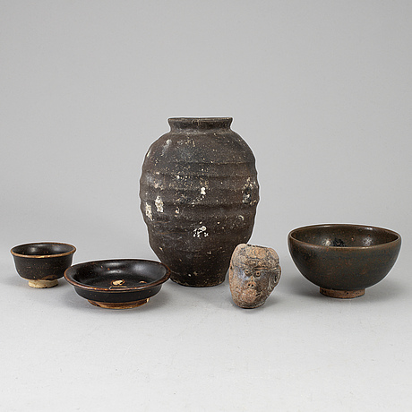 A group of five brown glazed south east asian ceramics, 19/20th century.