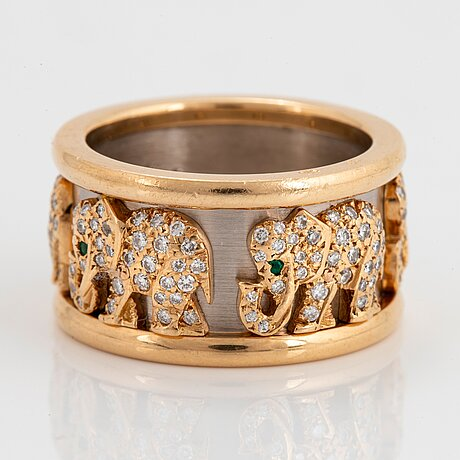 """A cartier """"elephant"""" ring in 18k gold and white gold set with round brilliant-cut diamonds and emeralds."""
