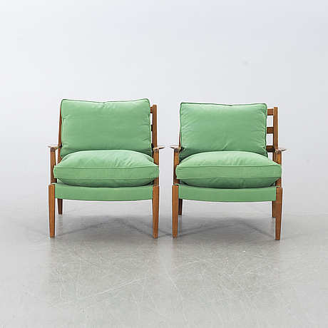 A pair of 'löven' armchairs by arne norell, second half of the 20th century.