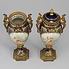 A pair of french porcelain urns, 20th century.