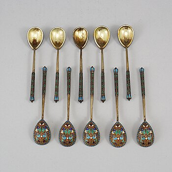 A Russian early 20th century set of ten silver-gilt and enamel tea-spoons, unidentified makers mark, Moscow 1899-1908.
