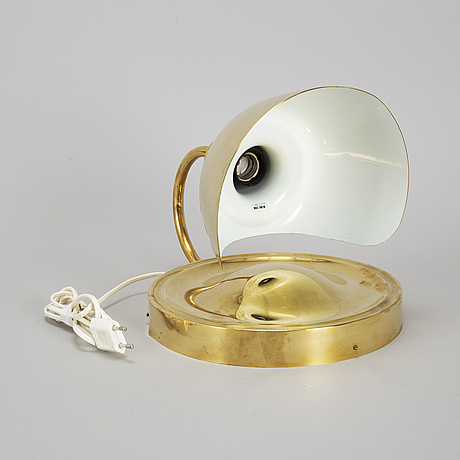 A brass wall light model 2389 by josef frank, firma svenskt tenn.