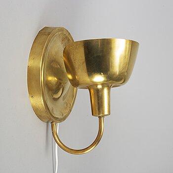 JOSEF FRANK, a brass wall light model 2389, Firma Svenskt Tenn.