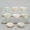 Eight white glazed southeast asian ceramic bowls, 16th/17th century.