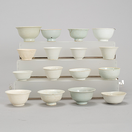 A group of 11 southeast asian and chinese white glazed cups, 19th century and also later.