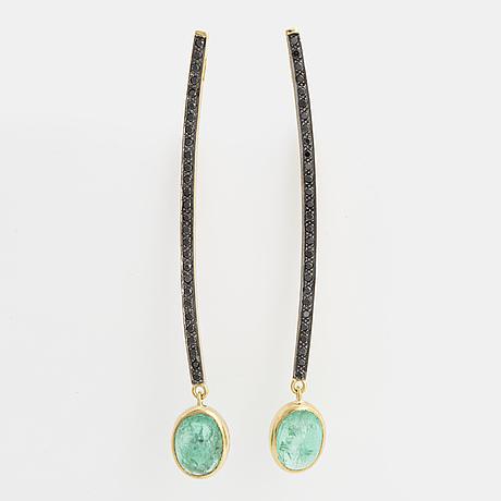 Cabochon-cut emerald and brilliant-cut black diamond earrings.