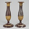A pair of biedermeier candlesticks, probably germany, first half of the 19th century.