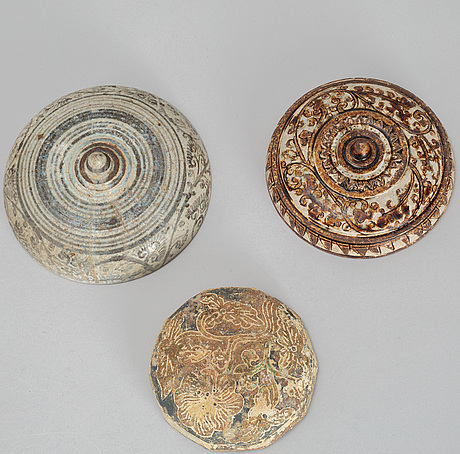 A group of three ceramic covers, including thailand, sawankhalok, 16th/17th century.