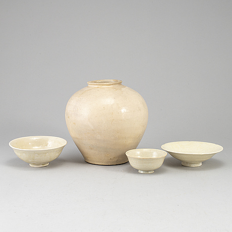 A group of white glazed south east asian ceramics, 20th century or earlier. (4 pieces).