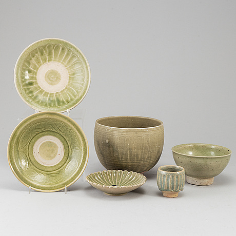A group of olive green glazed bowls, south east asia, 20th century. (6 pieces).
