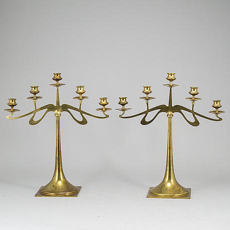 An early 20th century pair of art noveau brass candelabras by georg wojdikow malmö,