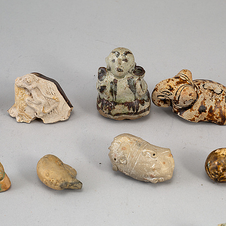 A group of 21 southeast asian ceramic figurines/sculptures,  19-20th century.