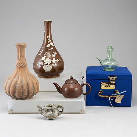 A group of five objects, southeast asian, china.
