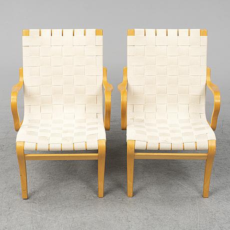 Bruno mathsson, a pair of 'mina' armchairs from bruno mathsson international, värnamo, 1997.