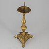 A bronze candlestick, 17th/18th century.