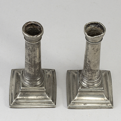 A pair of 18th century pewter candlesticks, london.