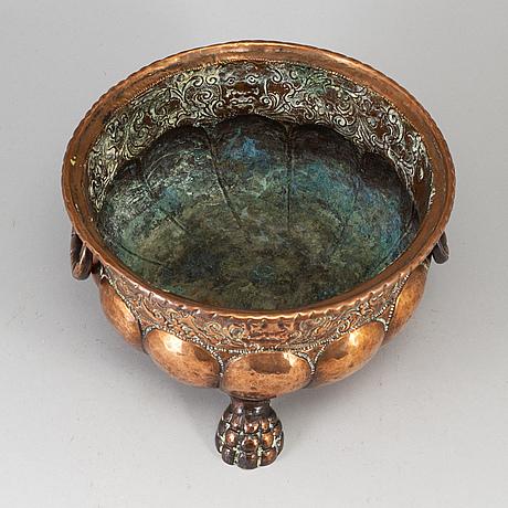 A 19th century copper champagne cooler.