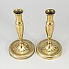 A pair of brass candlesticks, first half of the 19th century.