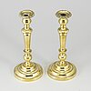 A pair of bronze candlesticks, first half of the 19th century.