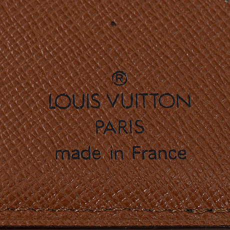Louis vuitton, a wallet and a key holder.