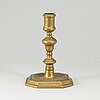An 18th century bronze candlestick.