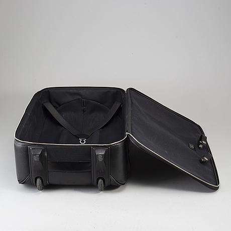 A black ardosie leather pégase 55 suitcase.