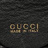 Gucci, a leather bag/briefcase.