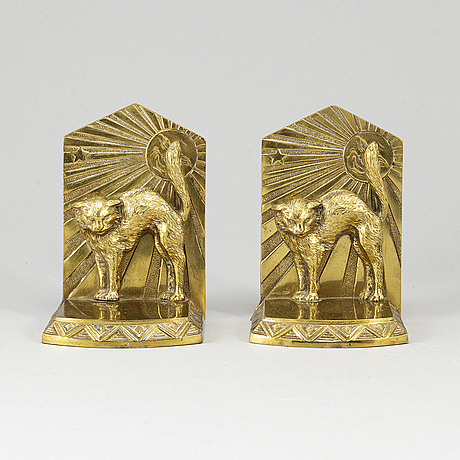 A pair of art déco bronze book ends, 1930s.