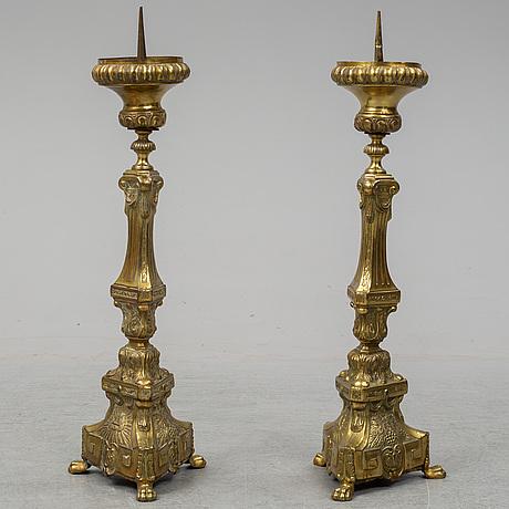 A pair of 18th century brass floor candlesticks.