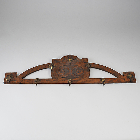 A 19th century bronze and wood clothes hanger.