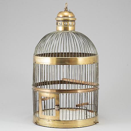 A 19th century brass bird cage.