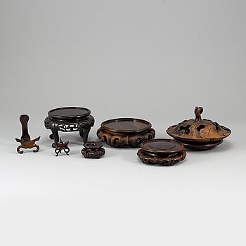 A group of six wooden stands and two covers, China, 19th/20th Century.