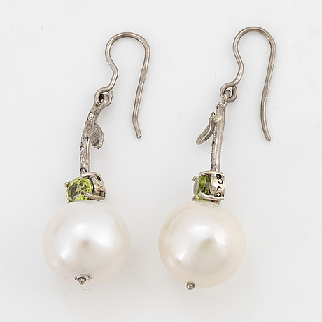 Cultured freshwater pearl, peridot and brilliant-cut diamond ring.