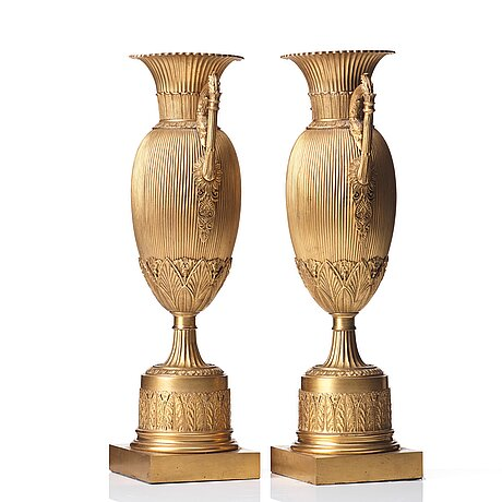 A pair of empire-style urns, late 19th century.