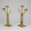 A pair of art nouveau brass candelabra, early 20th century.