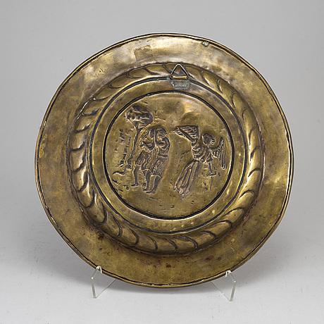 A renaissance style brass dish, late 19th century.