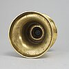 A capstan candlestick, brass, probably 16th or 17th century.