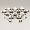 Tiffany & co, a set of twelve butter pat dishes and two spoons, sterling silver, first half of the 20th century.