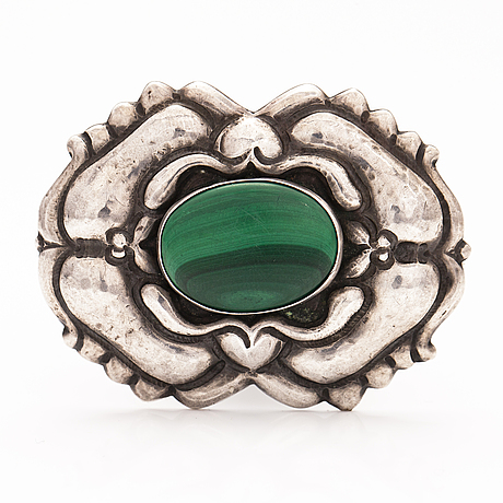 A jugend silver brooch with a malakite.