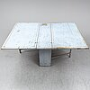 A 18th century painted gate leg table.