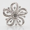 An 18k white gold brooch set with round brilliant-cut diamonds with a total weight of ca 2.50 cts.