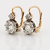 A pair of 14k gold earrings set with old-cut diamonds with a total weight of ca 2.50 cts.